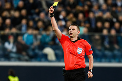 February 21, 2019 - Saint Petersburg, Russia - Referee Michael Oliver shows yellow card during the UEFA Europa League Round of 32 second leg match between FC Zenit Saint Petersburg and Fenerbahce SK on February 21, 2019 at Saint Petersburg Stadium in Saint Petersburg, Russia. (Credit Image: © Mike Kireev/NurPhoto via ZUMA Press)