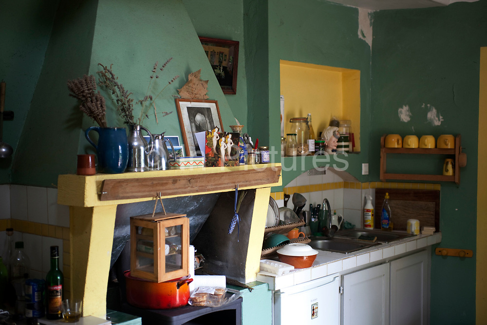 Scene inside a French country village house. This classical place with it's objects looks like a still life of French living. The kitchen