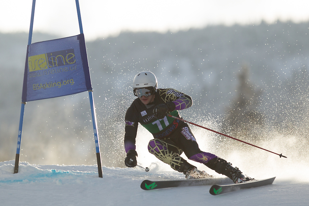 Timothy Spangler of Saint Michael's College, skis during the first run of the men's giant slalom at the Colby College Carnival at Sugarloaf Mountain on January 17, 2014 in Carabassett Valley, ME. (Dustin Satloff/EISA)
