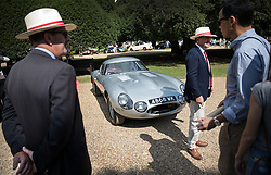 © Licensed to London News Pictures. 02/09/2017. London, UK. Officials surround a 1964 Jaguar Lindner-Nocker Low-drag Lightweight E-Type on display at the Concours of Elegance show in the grounds of Hampton Court Palace. The Concours of Elegance brings together, over three days, a selection of 60 of the rarest cars from around the world some of which have never been seen before in the UK. Each car owner is asked to vote on the other models on display to decide which car is considered to be the 'Best of Show'. The show also displays of hundreds of other fine motor cars, including entrants to The Club Trophy. Photo credit: Peter Macdiarmid/LNP