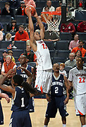 CHARLOTTESVILLE, VA- December 3: Mike Scott #23 of the Virginia Cavaliers dunks the ball over Longwood Lancer defenders during the game on December 27, 2011 at the John Paul Jones Arena in Charlottesville, Virginia. Virginia defeated Longwood 86-53. (Photo by Andrew Shurtleff/Getty Images) *** Local Caption *** Mike Scott