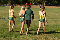 Boston College Invitational Cross Country race at Franklin Park; Oregon runners with coach Maurica Powell