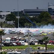 A big wreck occurs in turn three during the 56th Annual NASCAR Coke Zero 400 race at Daytona International Speedway on Sunday, July 6, 2014 in Daytona Beach, Florida. (AP Photo/Alex Menendez)