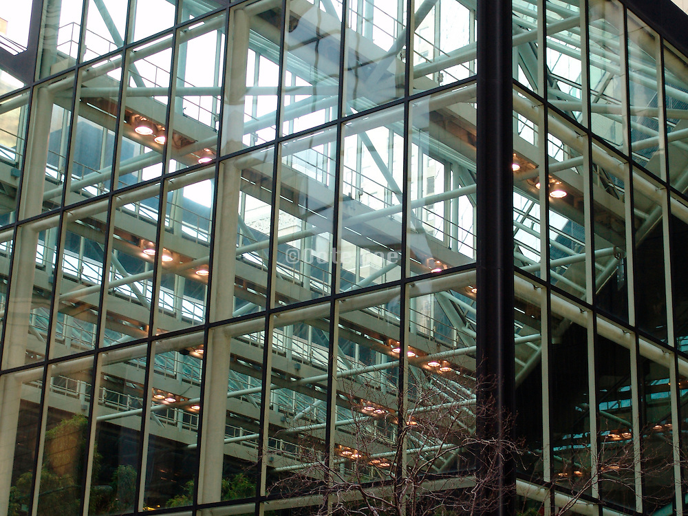The corner of a glass atrium seen from outside.