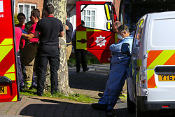 © Licensed to London News Pictures. 06/09/2020. London, UK. A forensic officer and a firemen outside a property on The Link, Enfield in north London were a woman died following a house fire. London Fire Brigade was called to the scene at 2.19am early this morning. Firefighters wearing breathing apparatus bought a woman out of the property and she was pronounced dead at the scene. The fire is under investigation. Photo credit: Dinendra Haria/LNP