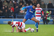 AFC Wimbledon defender Terell Thomas (6) battles for possession during the The FA Cup match between AFC Wimbledon and Doncaster Rovers at the Cherry Red Records Stadium, Kingston, England on 9 November 2019.