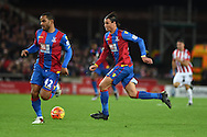 Marouane Chamakh of Crystal Palace ® makes a break.Barclays Premier league match, Stoke city v Crystal Palace at the Britannia Stadium in Stoke on Trent, Staffs on Saturday 19th December 2015.<br /> pic by Andrew Orchard, Andrew Orchard sports photography.