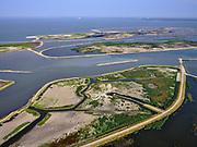 Nederland, Flevoland, Markermeer, 26-08-2019; Marker Wadden in het Markermeer.  Gezien vanuit het Westen, met vogelkijkhut (Lelystad in de achtergrond).<br /> Doel van het project van Natuurmonumenten en Rijkswaterstaat is natuurherstel, met name verbetering van de ecologie in het gebied, in het bijzonder de kwaliteit van bodem en water<br /> Naast het hoofdeiland is er inmiddels een tweede eiland in wording, de uiteindelijk Marker Wadden archipel zal uit vijf eilanden bestaan. <br /> Marker Wadden, artifial islands. The aim of the project is to restore the ecology in the area, in particular the quality of soil and water.<br /> The first phase of the construction, the main island, is finished. <br /> <br /> luchtfoto (toeslag op standard tarieven);<br /> aerial photo (additional fee required);<br /> copyright foto/photo Siebe Swart