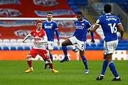 Cardiff City's Leandro Bacuna (7) under pressure from Millwall's Ryan Woods (19) during the EFL Sky Bet Championship match between Cardiff City and Millwall at the Cardiff City Stadium, Cardiff, Wales on 30 January 2021.