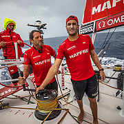 Leg 8 from Itajai to Newport, day 08 on board MAPFRE, Joan Vila and Blair Tuke looking at the clouds, Pablo Arrarte steering. 29 April, 2018.