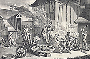 Putting tyre on a wheel. From Diderot 'Encyclopedie' c1751.