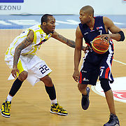 Fenerbahce Ulker's Tarence Anthony KINSEY (L) and Efes Pilsen's Charles SMITH (R) during their Turkish Basketball league Play Off Final third leg match Fenerbahce Ulker between Efes Pilsen at the Abdi Ipekci Arena in Istanbul Turkey on Tuesday 25 May 2010. Photo by TURKPIX