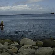 Lone swimmer in Kapalua on island of Maui.