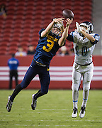 Milpitas defensive back Oliver Svirsky, 3, gets his finger tips on a pass intended for Valley Christian's wide receiver Anthony Flores, 10, during Friday Night Lights at Levi's Stadium in Santa Clara, California, on September 18, 2015.  Milpitas went on to lose 22-21 against Valley Christian.  (Stan Olszewski/SOSKIphoto)