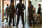 "09 JANUARY 2105 - BANGKOK, THAILAND: Thai police wait for former Prime Minister Yingluck Shinawatra at the entrance to Parliament House in Bangkok. Thailand's military-appointed National Legislative Assembly began impeachment hearings Friday against former Prime Minister Yingluck Shinawatra. If she is convicted, she could be forced to stay out of politics for five years. During her defense, Yingluck questioned the necessity of her impeachment, saying, ""I was removed from office, the equivalent of being impeached, three times already, I have no position left to be impeached from."" A decision on her impeachment is expected by the end of January.    PHOTO BY JACK KURTZ"