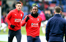 Crystal Palace's Michy Batshuayi (centre) warms up on the pitch prior to the Premier League match at Selhurst Park, London.