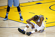 Golden State Warriors forward Kevin Durant (35) covers his face after being fouled against the Memphis Grizzlies at Oracle Arena in Oakland, Calif., on December 20, 2017. (Stan Olszewski/Special to S.F. Examiner)