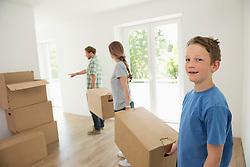 Young family father mother boy relocation