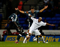 Fotball<br /> England 2005/2006<br /> Foto: SBI/Digitalsport<br /> NORWAY ONLY<br /> <br /> Bolton Wanderers v Newcastle United. The Barclays Premiership. 24/08/2005.<br /> <br /> Bolton's El Hadji Diouf (R) tries to keep the ball against Newcastle's Amdy Faye and Steven Taylor