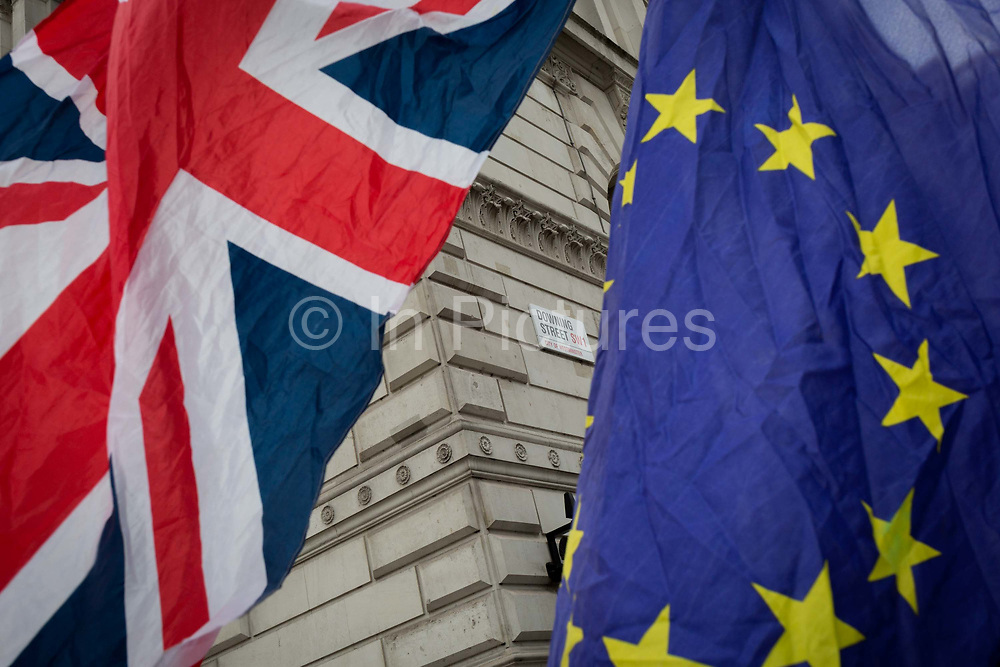 As the EUs Chief negotiator Michel Barnier meets Theresa May in London to discuss the next stage of Brexit, the Union jack and the stars of the EU flag belonging to to anti-Brexiter flies in Whitehall and the corner of Downing Street, the official residence of the Prime Minister, on 5th February 2018, in London England.