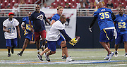 Torry Holt catches a pass from Marc Bulger and takes off for a touchdown run to the end zone.