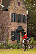 A ounted Fox Hunter waits for the start of the hunt on the greensward of the plantation house at Middleton Place plantation in Charleston, SC.