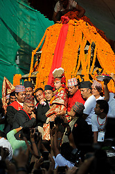 September 15, 2016 - Kathmandu, NE, Nepal - Devotees carrying Goddess 'Kumari' for the chariot pulling festival on the third day of Indra Jatra Festival celebrated at Basantapur Durbar Square, Kathmandu, Nepal on Thursday, September 15, 2016. Devotees celebrated the god of rain 'Indra' for 8 days in Kathmandu. (Credit Image: © Narayan Maharjan/NurPhoto via ZUMA Press)