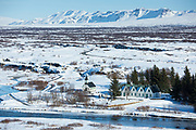 View from above of snow-covered, famous tourist sight Thingvellir National Park - Pingvellir - church and summer residence of Prime Minister of Iceland