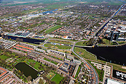 Nederland, Groningen, Gemeente Groningen, 01-05-2013; Oosterhogebrug, met woonschepenhaven en woontoren Tasmantoren. Knooppunt van waterwegen: begin van Van Starkenborghkanaal met Oostersluis (li), Eemskanaal. Sportcentrum Kardinge in de achtergrond.<br /> View on the city of Groningen and surroundings, residential tower Tasmantoren , Eemskanaal crossing Van Starckenborghkanaal (channels) . Oostersluis (sluice) center picture.<br /> luchtfoto (toeslag op standard tarieven)<br /> aerial photo (additional fee required)<br /> copyright foto/photo Siebe Swart