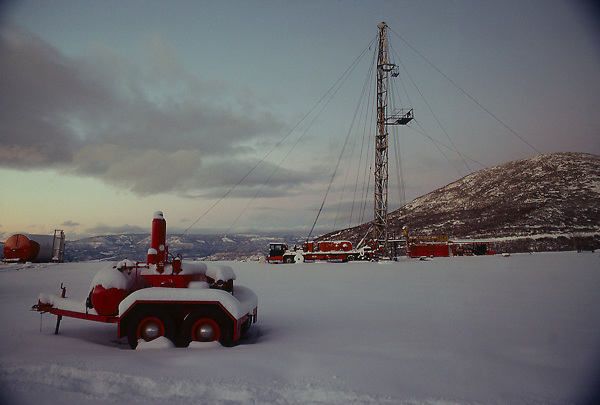 Stock photo of a snow covered oil and gas drilling rig on location in the Colorado mountains