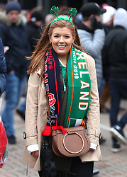 An Ireland fan shows her support prior to the NatWest 6 Nations match at Twickenham Stadium, London.