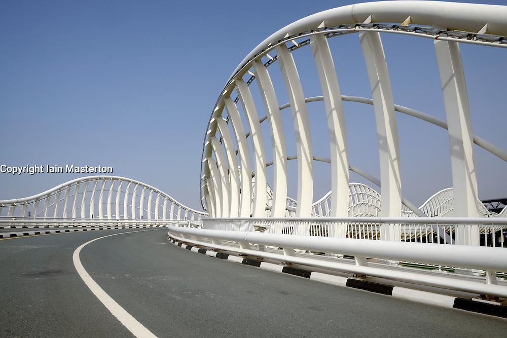 Modern highway bridge at approach to Al Meydan racecourse in Dubai United Arab Emirates