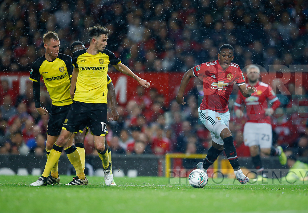 Anthony Martial of Manchester United gets past three Burton defenders during the Carabao Cup Third Round match at the Old Trafford Stadium, Manchester. Picture date 20th September 2017. Picture credit should read: Simon Bellis/Sportimage