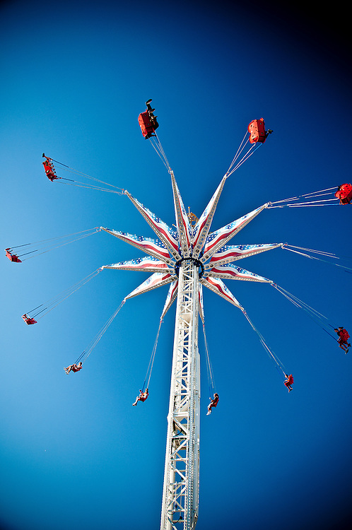 People hanging from a swing in the Coney Island amusement park, brooklyn, New York, 2010.
