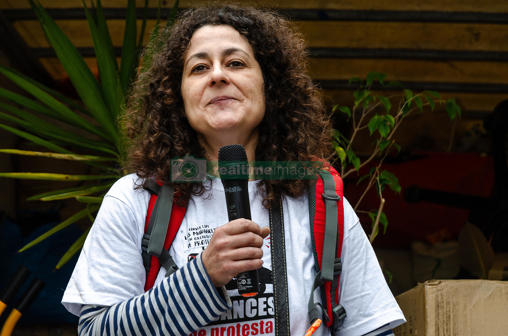 May 5, 2018 - Barcelona, Catalonia, Spain - Sandra is seen climbing in the truck while addressing a few words to the people who have helped move her home. Organized by the Federation of Neighborhood Associations of Barcelona (FVAB), a group of people have collaborated in solidarity in moving Sandra and Jesus home to a new place. They are neighbors of the old industrial district of Pueblo Nuevo (Barcelona)  and  they suffer immobiliary pressure. Their apartment has been bought by an investment fund that does not intend to renew the rental contract, which has forced them  to move to a new residence. The circumstance occurs that Sandra's great-grandfather already occupied the house and Sandra has lived in it for 46 years. (Credit Image: © Paco Freire/SOPA Images via ZUMA Wire)