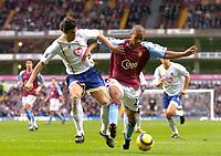 Fotball<br /> Premier League 2004/2005<br /> 06.11.2004<br /> Foto: SBI/Digitalsport<br /> NORWAY ONLY<br /> <br /> Aston Villa v Portsmouth<br /> <br /> Aston Villa's Luke Moore (R) battles for the ball with Dejan Stefanovic