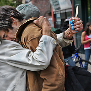 Homeless and destitute, Pat finds comfort in the arms of a long time friend in Vancouver, Canada.