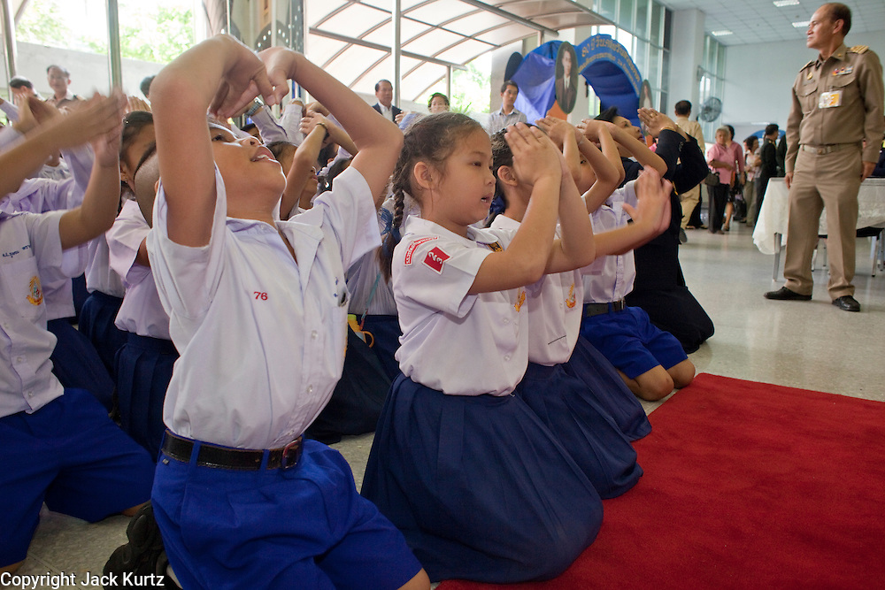 Sept. 22, 2009 -- BANGKOK, THAILAND:  Thai school children pray in the lobby of Siriraj Hospital  for King Bhumibol Adulyadej, the 81-year-old King of Thailand. The King has been admitted to hospital suffering from a fever. Doctors at Siriraj Hospital said the world's longest-serving monarch, had shown signs of fatigue and was being treated with antibiotics. King Bhumibol is deeply revered by most Thais and his health is a matter of public anxiety. His Majesty was admitted on Saturday suffering from a fever, fatigue and loss of appetite. Doctors continued to treat the King with intravenous drips and antibiotics, hospital officials said. More than 3,500 people have come to the hospital to pray for the King's speedy recovery and to sign get well cards for him.  Photo by Jack Kurtz