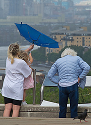 ©Licensed to London News Pictures 02/07/2020     <br /> Greenwich, UK. A mother and child holding onto an umbrella. People out and about in Greenwich Park, Greenwich, London today as the Coronavirus lockdown is eased. The weather continues to be unsettled with heavy rain and sunshine. Photo credit: Grant Falvey/LNP
