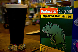 The craziest pub ever; A bar and hardware store all in one.  Here is part of the bar with rat poison for sale where our beers sat.