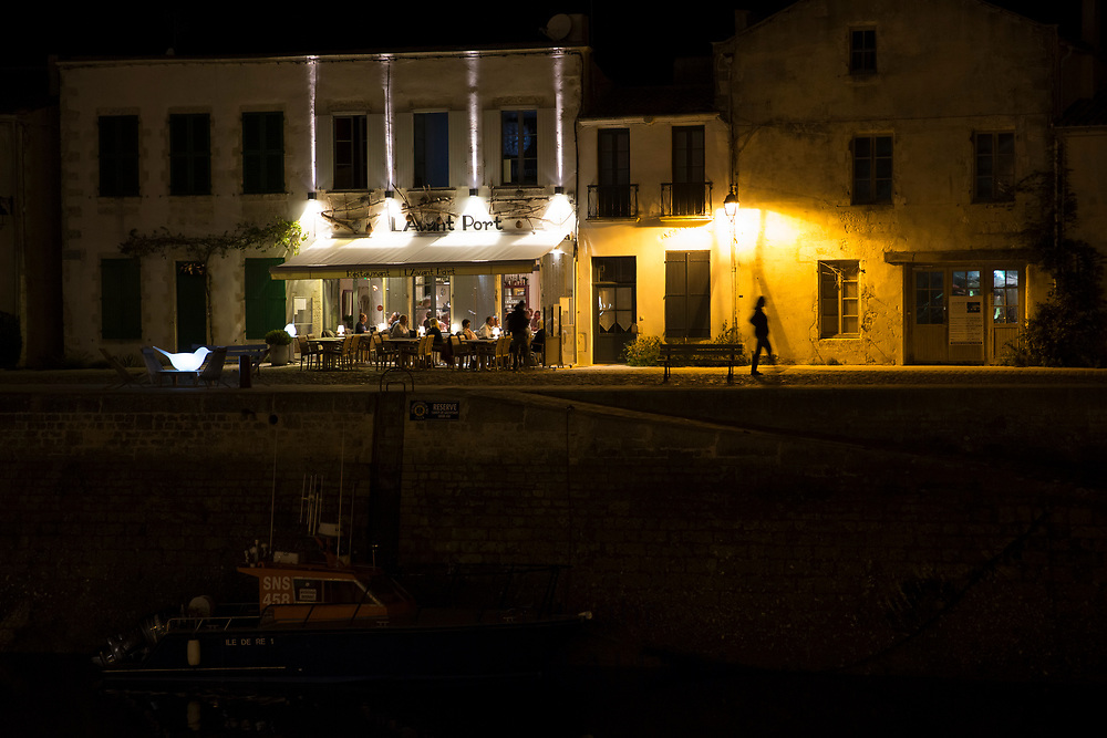 Harbour view and evening al fresco dining street scene at St Martin de Re on Ile de Re, France