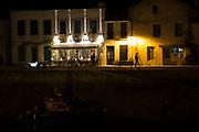 Harbour view and evening al fresco dining street scene at St Martin de Re on Ile de Re, France