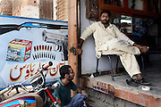 Celebrated young pakistani artist Asim Butt on a journey of political graffiti through Pakistan during the summer of 2009..Asim having just completed the piece 'For the waste alone' with a gun shop owner in the gun market in central Multan.