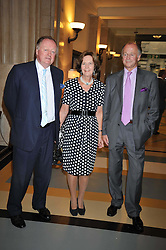 Left to right, ANDREW PARKER BOWLES, SIMON & CAROLYN PARKER BOWLES at the opeing of Green's Restaurant & Oyster Bar, 14 Cornhill, London EC3 on 1st September 2009.