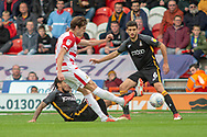 Doncaster Rovers forward John Marquis shoots and scores a goal 1-0 during the EFL Sky Bet League 1 match between Doncaster Rovers and Bradford City at the Keepmoat Stadium, Doncaster, England on 22 September 2018.