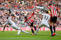 Ricardo Alvarez of Sunderland shoots as Ashley Williams and Federico Fernandez of Swansea City challenge - Photo mandatory by-line: Rogan Thomson/JMP - 07966 386802 - 27/08/2014 - SPORT - FOOTBALL - Sunderland, England - Stadium of Light - Sunderland v Swansea City - Barclays Premier League.