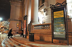Solo Man Dashing up the Steps of Woolsey Hall before the Concert. Century on a Spree: The Whiffenpoof Centennial (1909-2009)