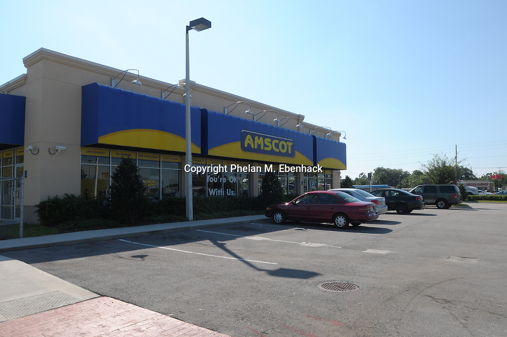 This AMSCOT business located on the corner of Goldenrod Rd. and E. Colonial Dr. is from where Casey Anthony's car was towed after running after gas.  The photo was made on Friday, Sept. 26, 2008.  Casey Anthony is the mother of missing three-year-old Caylee Anthony.