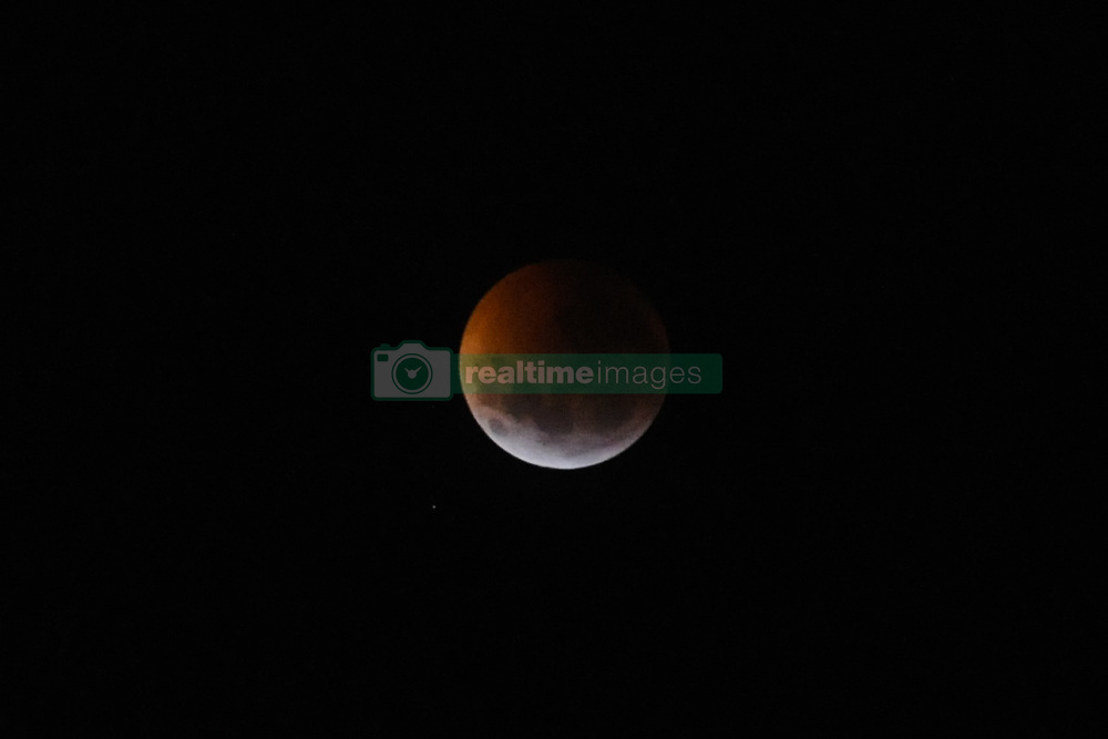 January 21, 2019 - Buenos Aires, Argentina - A supermoon is seen on Monday, January 21, 2019 in Buenos Aires, Argentina. The first super moon of the year, when the full moon appears a bit bigger and brighter because it is a little closer to Earth, is one of the two lunar events on Sunday. If the sky is clear, a total eclipse will also be visible in North and South America, and in parts of Europe. (Credit Image: © Gabriel Sotelo/NurPhoto via ZUMA Press)