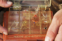 Dry flies in the box of Arthur Fernandes for fishing in the river Allier. Pont-du-Chateau, Auvergne, France.